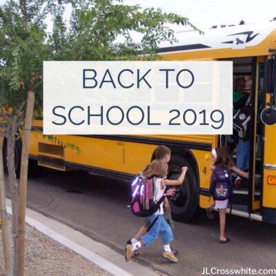 Kids getting on the school bus.